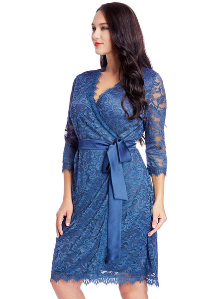Angled shot of model in plus size blue lace crop sleeves wrap dress