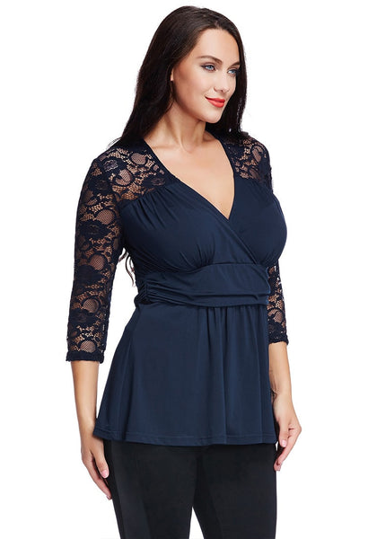 Angled shot of model in plus size navy lace navy wrap top