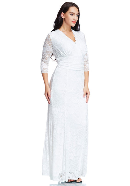 Angled shot of model in plus size white lace long dress