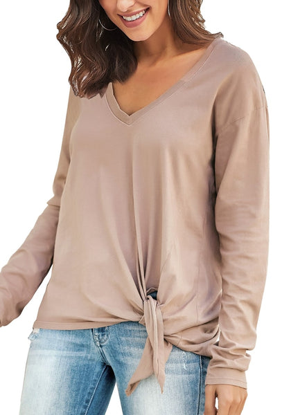 Angled shot of model in taupe V-neckline side-tie knot long sleeves loose top