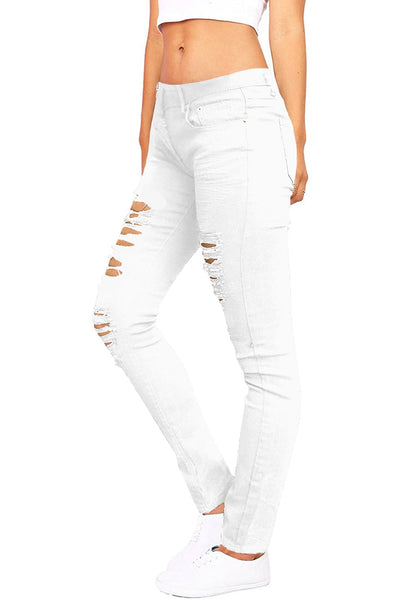 Angled shot of model in white distressed skinny jeans