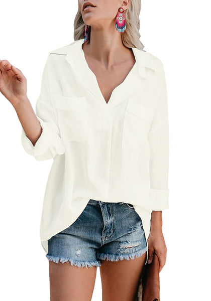 Angled shot of model in white long sleeves lapel collar high-low loose top