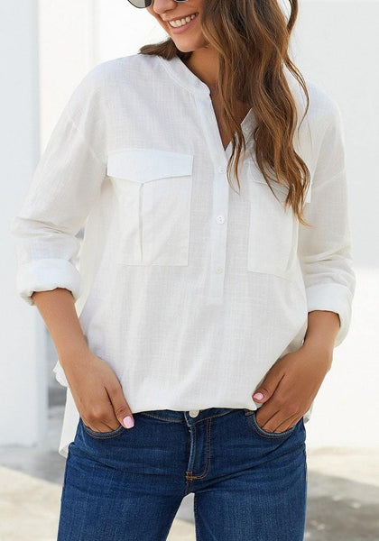 Angled shot of model in white notched henley cuffed sleeves blouse