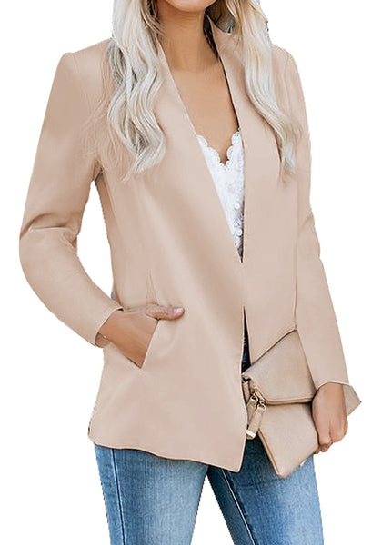 Angled shot of model wearing apricot open-front side pockets blazer