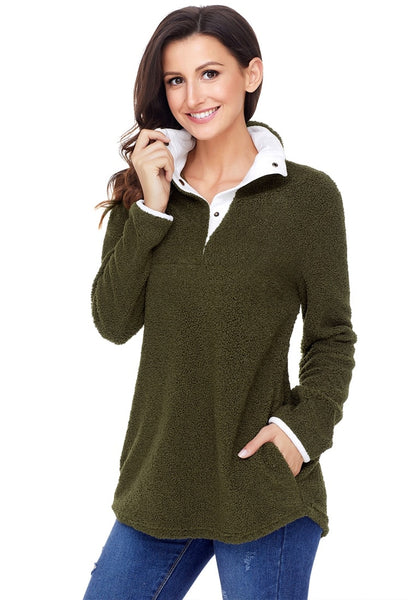 Angled shot of model wearing army green button-front fleece pullover