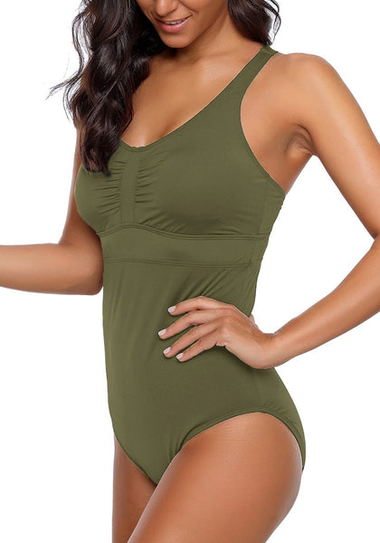 Angled shot of model wearing army green ruched crisscross-back monokini