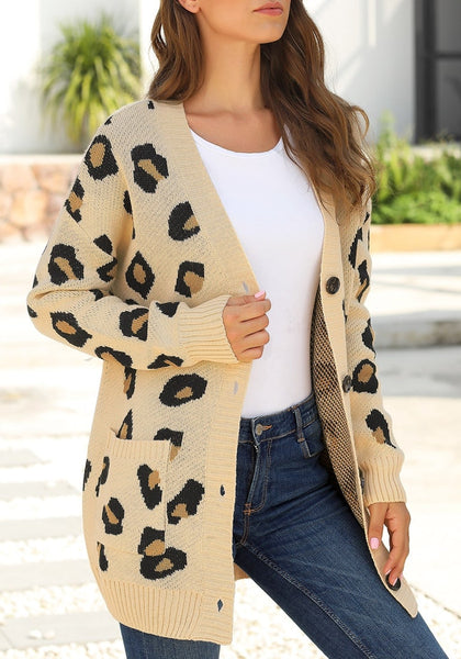 Angled shot of model wearing beige leopard-print button-up sweater cardigan