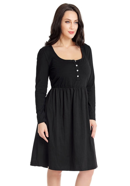 Angled shot of model wearing black button-front long sleeves skater dress