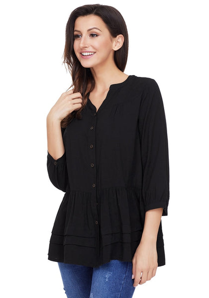 Angled shot of model wearing black button-front puffed sleeves tunic