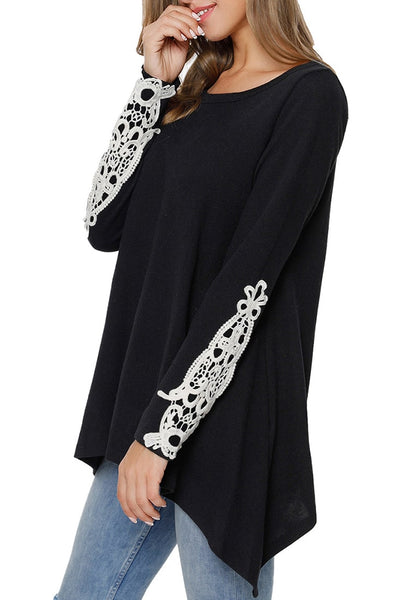 Angled shot of model wearing black crochet applique long sleeves asymmetrical top