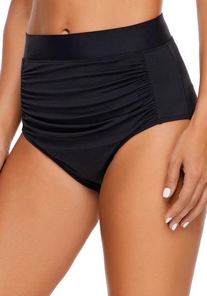 Angled shot of model wearing black high waist ruched bikini bottom