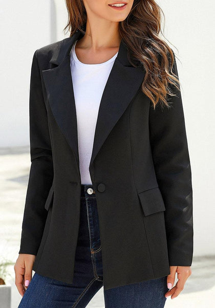 Angled shot of model wearing black lapel front-button side-pockets blazer