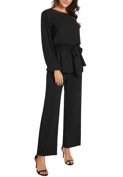 Angled shot of model wearing black long sleeves slit-back peplum jumpsuit