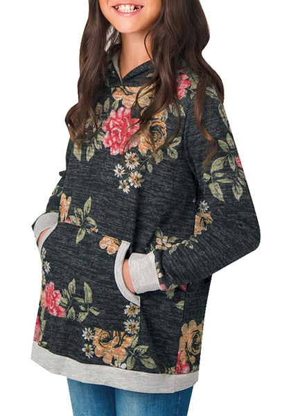 Angled shot of model wearing black melange floral-print hooded pullover girl top
