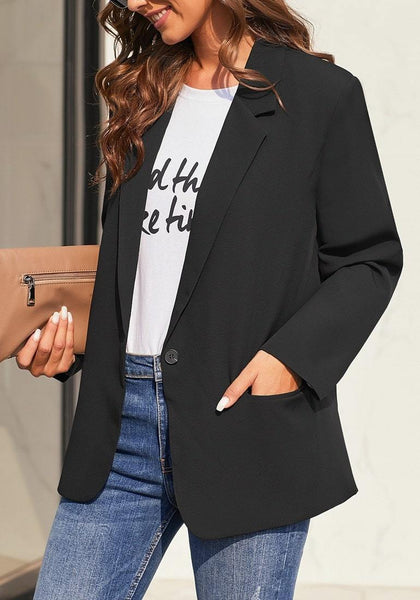 Angled shot of model wearing black notch lapel single-button plain blazer