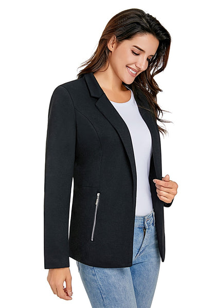 Angled shot of model wearing black notched lapel side zip blazer