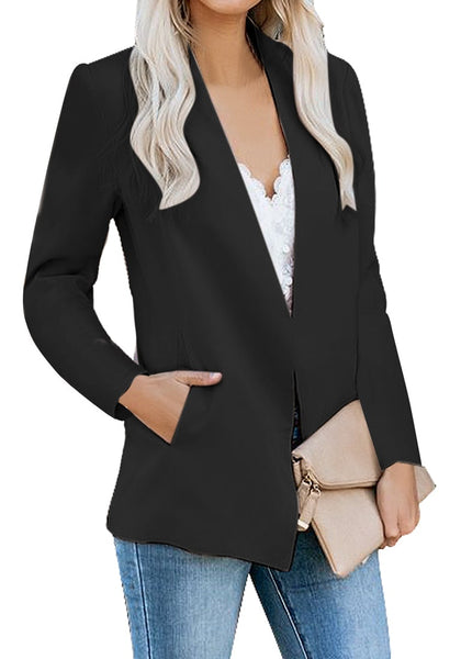 Angled shot of model wearing black open-front side pockets blazer