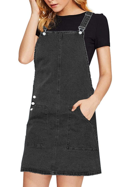 Angled shot of model wearing black side pockets overall denim pinafore dress