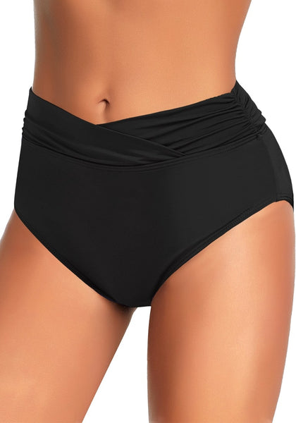 Angled shot of model wearing black surplice-waist ruched bikini bottom