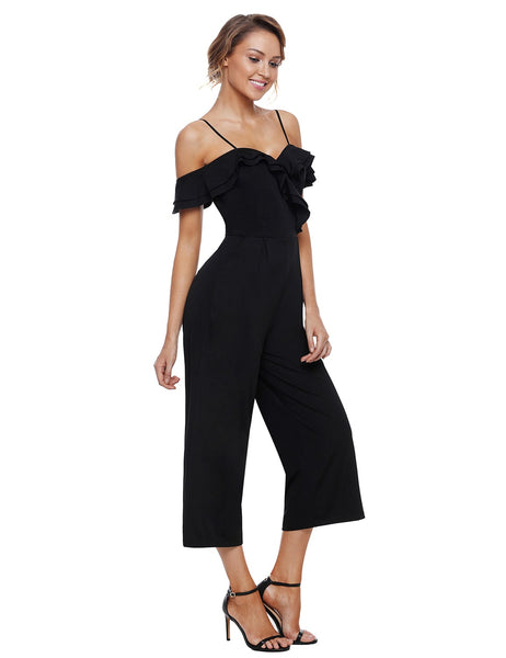 Angled shot of model wearing black sweetheart neckline cold-shoulder jumpsuit