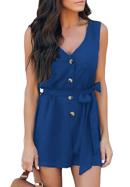 Angled shot of model wearing blue V-neck sleeveless belted button-up romper