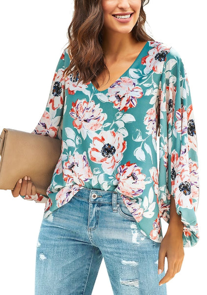 Angled shot of model wearing blue V-neckline balloon sleeve floral blouse