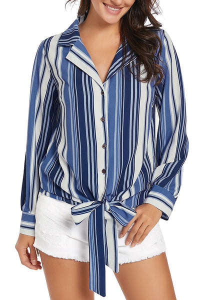 Angled shot of model wearing blue long sleeves tie front striped button-up top