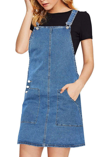 Angled shot of model wearing blue side pockets overall denim pinafore dress