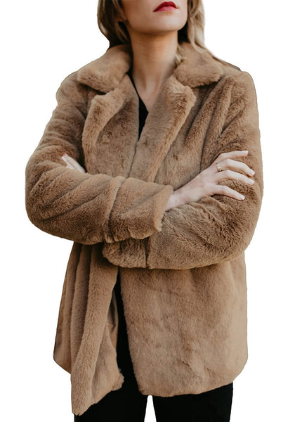 Angled shot of model wearing brown notch collar oversized fleece jacket