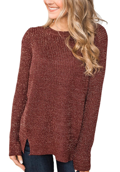 Angled shot of model wearing burgundy velvet knit side-slit pullover sweater