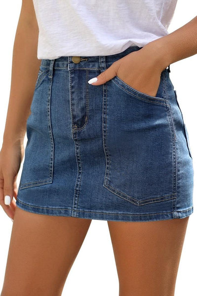 Angled shot of model wearing dark blue mid-waist patch pockets denim mini skirt