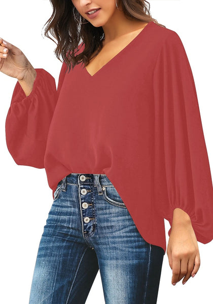 Angled shot of model wearing dark coral pink V-neckline balloon sleeve plain blouse