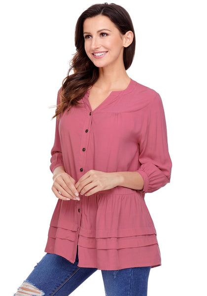 Angled shot of model wearing deep blush button-front puffed sleeves tunic