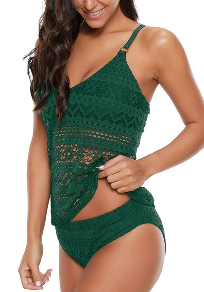Angled shot of model wearing green lace crochet plunge neck tankini set