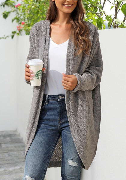 Angled shot of model wearing grey curved hem long chenille knit cardigan