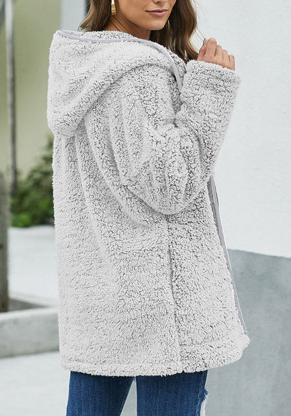 Angled shot of model wearing grey fuzzy fleece hooded open-front oversized coat