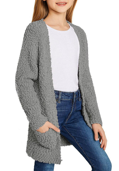 Angled shot of model wearing grey fuzzy fleece open-front girls' cardigan