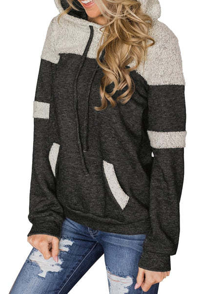 Angled shot of model wearing grey kangaroo pocket color block pullover hoodie top