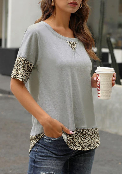 Angled shot of model wearing grey leopard patchwork half sleeves loose top