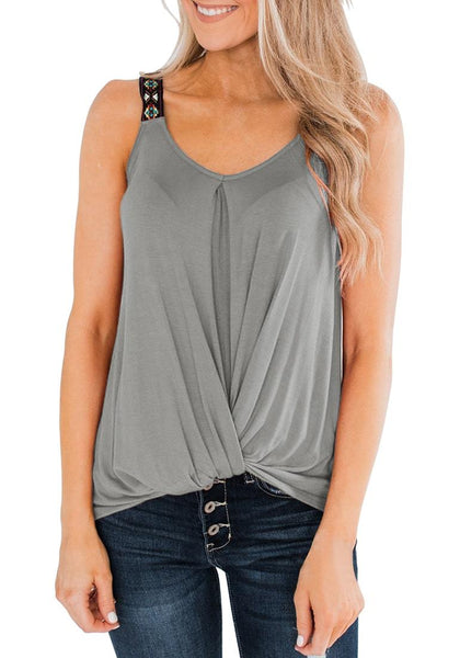 Angled shot of model wearing grey twist knot embroidered straps tank top
