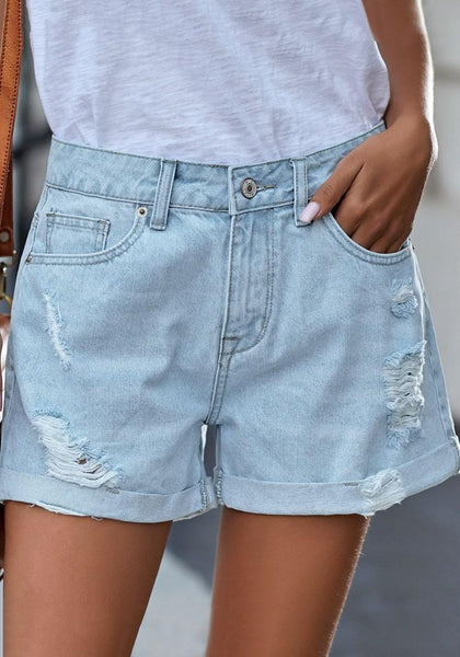 Angled shot of model wearing light blue roll-over distressed denim shorts