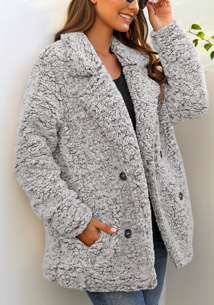 Angled shot of model wearing light grey notched lapel double breasted fuzzy fleece coat