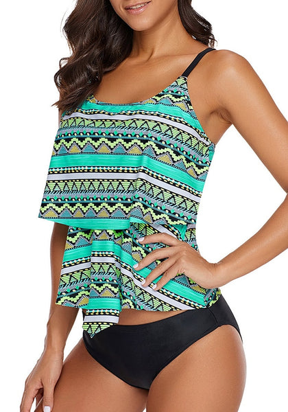Angled shot of model wearing mint green tribal print strappy-back layered tankini top