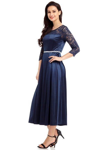Angled shot of model wearing navy lace-sleeve long satin dress