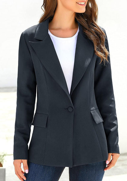 Angled shot of model wearing navy lapel front-button side-pockets blazer
