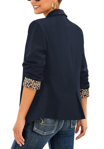 Angled shot of model wearing navy leopard lining back-slit notched lapel blazer's 3D image