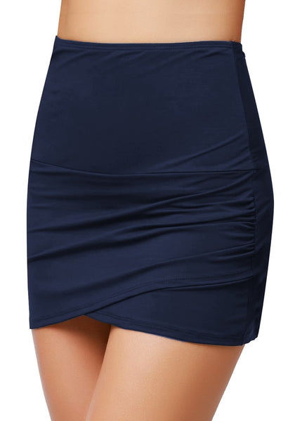 Angled shot of model wearing navy tulip hem high waist ruched swim skirt