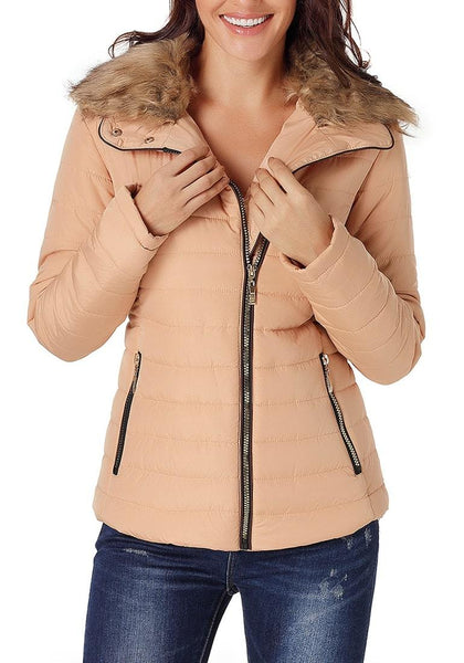 Angled shot of model wearing peach faux fur collar zip up quilted jacket