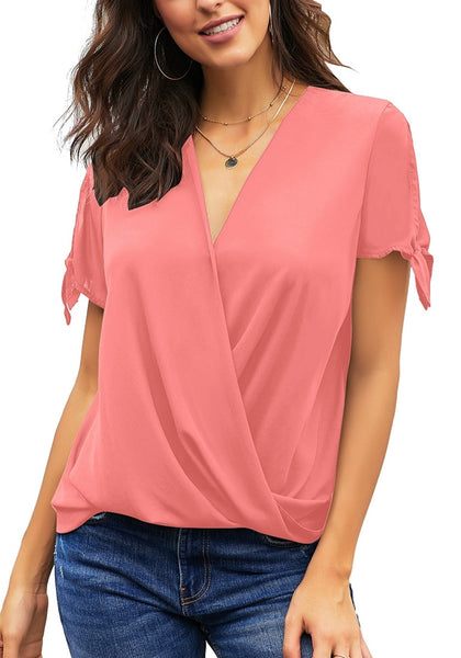 Angled shot of model wearing pink V-neck split tie sleeves loose surplice top