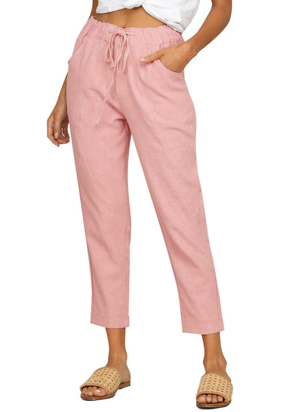 Angled  shot of model wearing pink drawstring-waist rolled-up cropped pants